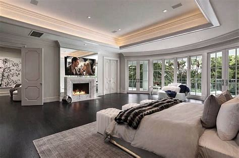 master suite  doors separating sitting areacloset double sided fire place master suite