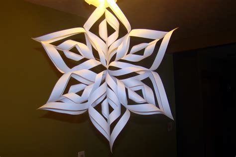 3d Paper Snowflakes - sitting at our kitchen table 3d paper snowflake