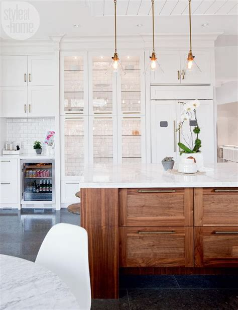 what to display in glass kitchen cabinets a trendy meets traditional family home house tours
