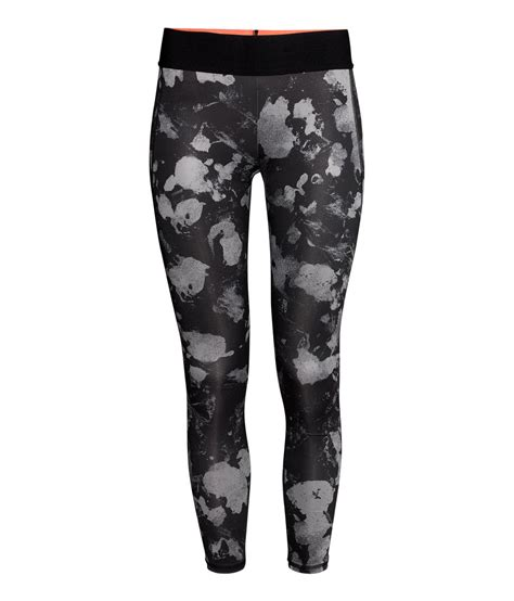 patterned sport leggings h m sports tights in black black patterned lyst