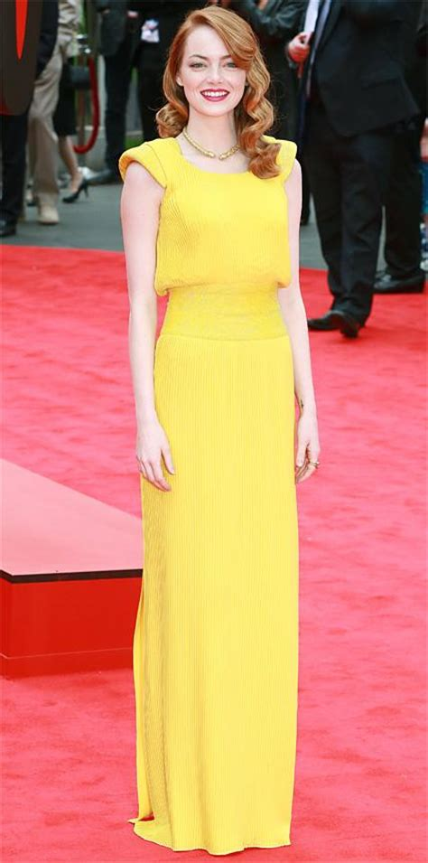 emma stone yellow versace look we re loving stars in yellow dresses instyle com