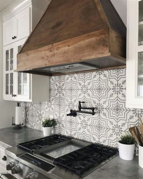 backsplash stove hood gas stove white cabinets