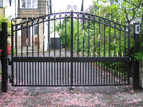 the iron gate man wrought iron garden fencing and decor designs