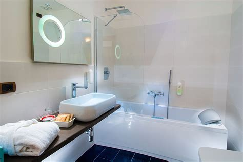 Neat Small Bathroom Design With Jacuzzi Shower Combination