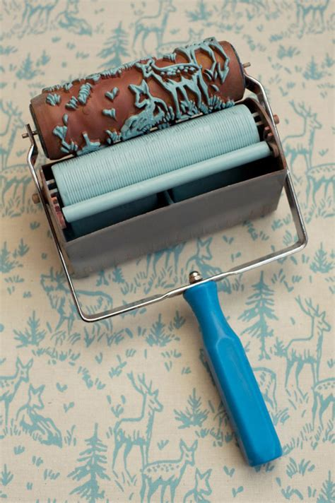 patterned paint roller easily recreating the look of a classic wallpaper