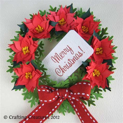 Poinsettia Paper Craft - you to see paper poinsettia and wreath on craftsy