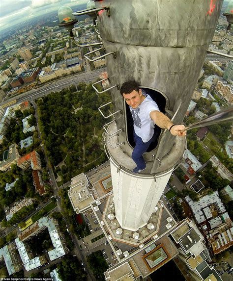 on top right pictures show russian daredevils dangling off the city s