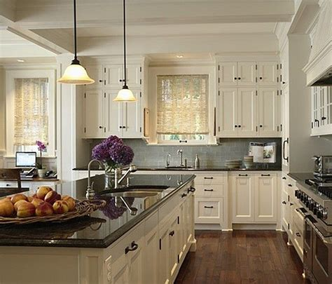 white kitchen cabinets with black countertops dark floors countertop light cabinets kitchens pantry pinterest grey countertops and tile