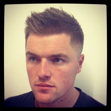haircuts for men with small heads a man with a regular fade haircut and short hair on his