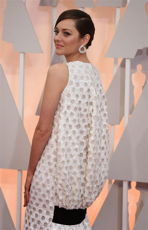 Marion Cotillards Oscar Dress From Runway To Carpet by Marion Cotillard In A Sequinned Polka Dotted Dress At