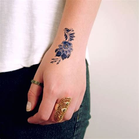Flower Tattoo In Hand | 31 small hand tattoos that will make you want one