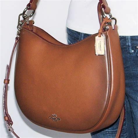 Coach Nomad 29 nwt coach nomad glovetanned burnished saddle leather