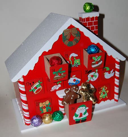 Handmade Wooden Advent Calendar - luxury advent calendar house with handmade truffles