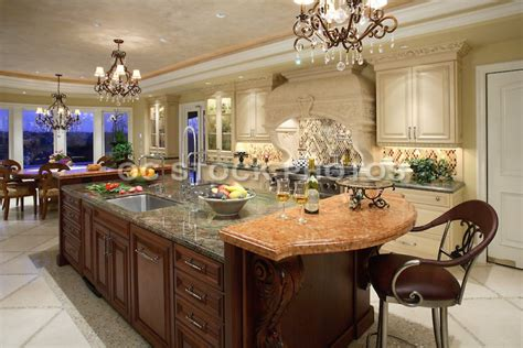this large custom kitchen island features two different types of