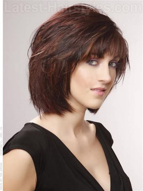 chin length layered bob with side bangs chin length layered haircuts