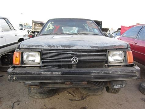 junkyard find  dodge omni glh  truth  cars