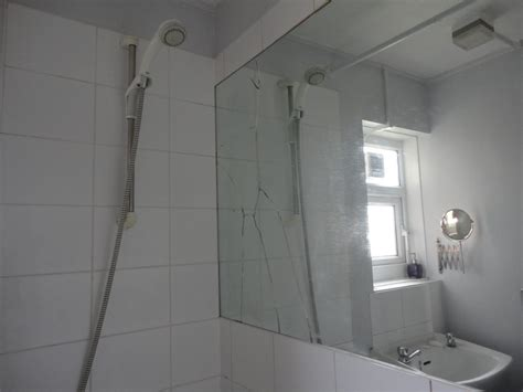 broken bathroom mirror replace cracked bathroom mirror handyman job in clapham