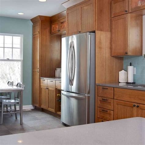 blue kitchen with oak cabinets oak cabinets colors for kitchens and stainless appliances