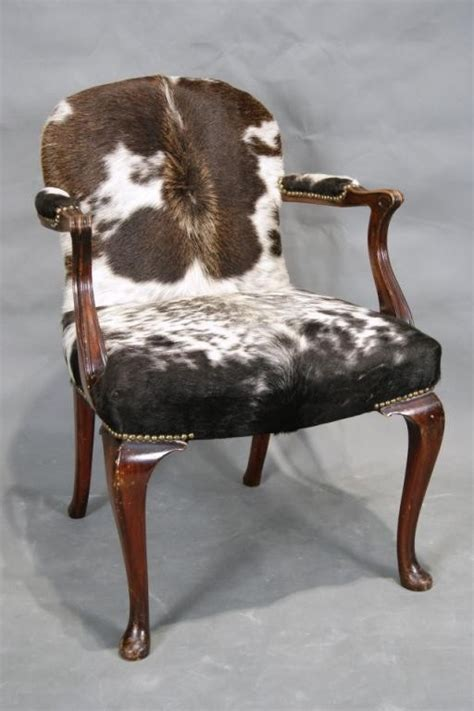 cowhide upholstery 17 best images about chair reupholstered on