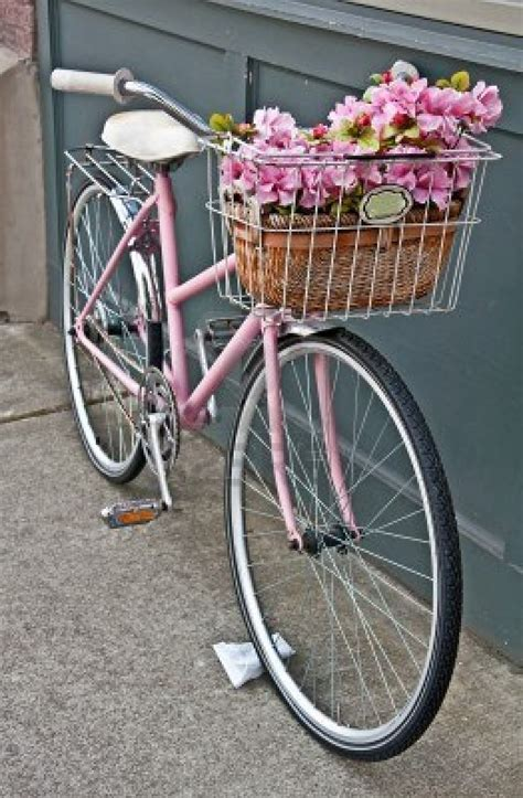 Setelan 3in1 Retro Pink this vintage pink bicycle has beautiful pink flowers in a basket on the front of the bike