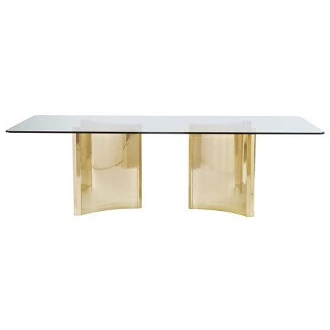 glass and gold dining table modern sleek gold pedestal glass dining table