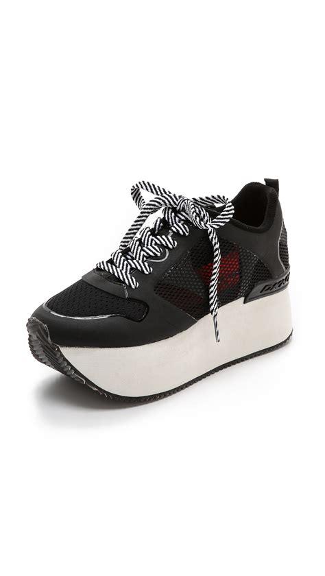 dkny shoes lyst dkny platform sneakers black in black