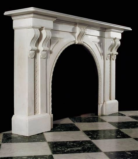 antique white statuary marble arched fireplace