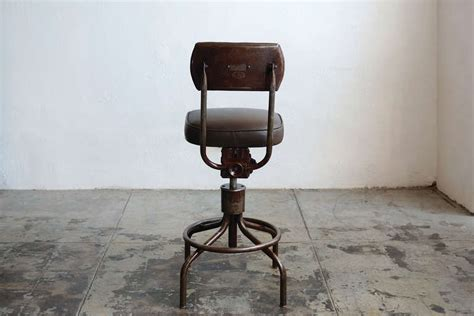 vintage drafting stool with back vintage machine age drafting stool with back at 1stdibs