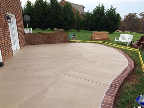 Stained concrete patio with a sprayed concrete brick