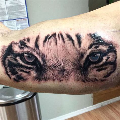 30 aggressive tiger face tattoo made ever