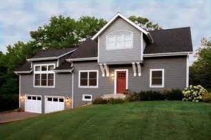 gray white with a black roof and shake siding details