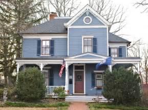 blue house white trim exteriors of houses