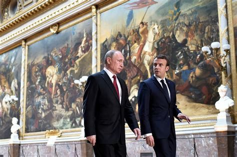 emmanuel macron russia macron meets russia s putin near paris promising tough talks