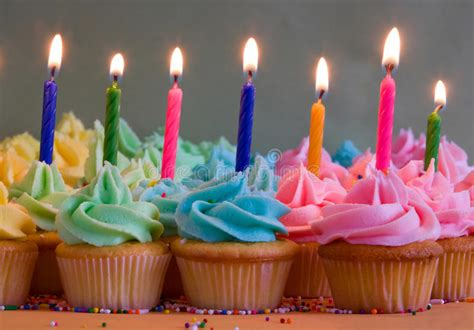 rainbow cake and cupcakes decorated with birthday candles birthday cupcakes with candles stock photo image of sprinkles rainbow 22626404
