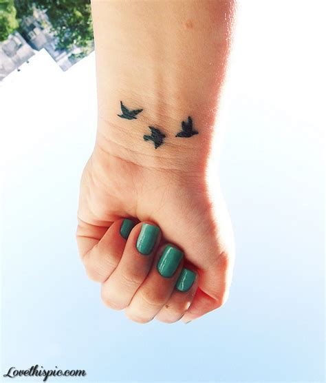 green nails and bird tattoos pictures photos and images
