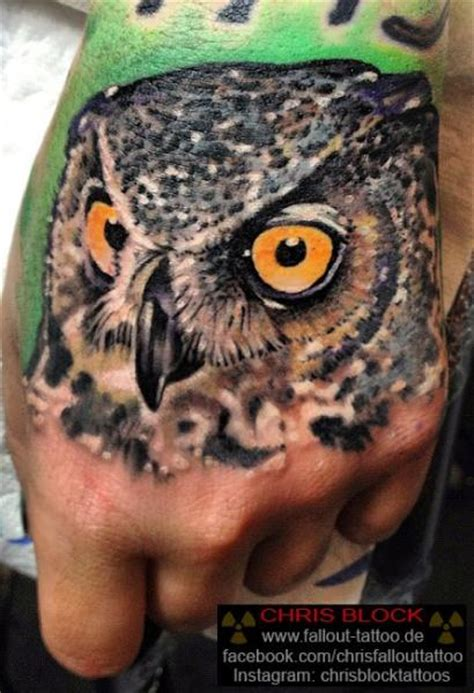 hand owl tattoo by fallout tattoo