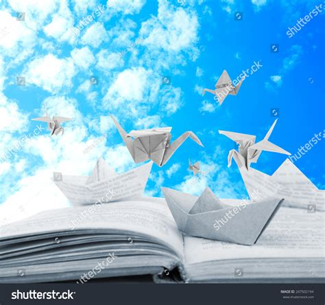 origami boat book origami boats cranes on book on stock photo 247502194