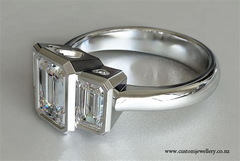 emerald cut three bezel set engagement ring new zealand