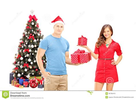 couple gift wallpaper smiling couple holding gifts and posing in front of a