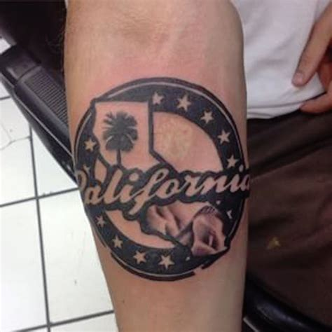 california tattoo design california on right forearm