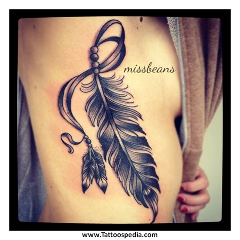 tattoo feather on thigh feather tattoo thigh 1