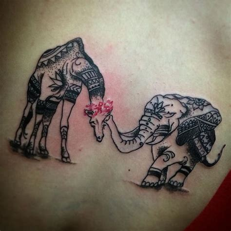 elephant and giraffe tattoo follow and tag inkedmagz to get featured by harry