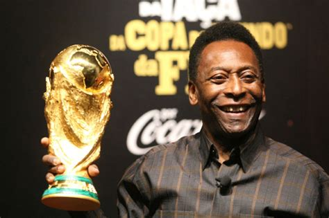 biography of pele in spanish pele poses with fifa s world cup trophy on display in