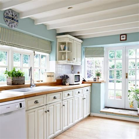 blue country kitchen with cabinetry housetohome co uk