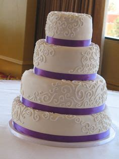 classic purple and white wedding cake with marzipan roses buttercream flowers wedding cake photos and cake photos