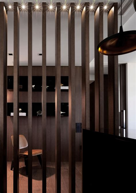 wooden partition wall sobriety with a touch of luxury in a modern spanish home