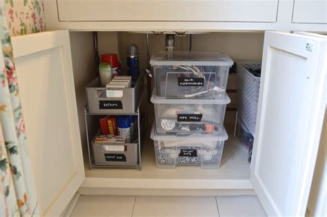 under bathroom sink shelf how to organize under a bathroom sink