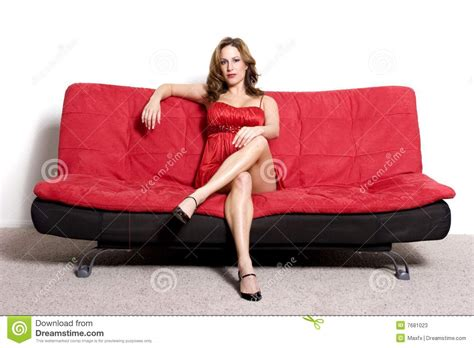 sitting on a sofa woman sitting on sofa stock photos image 7681023