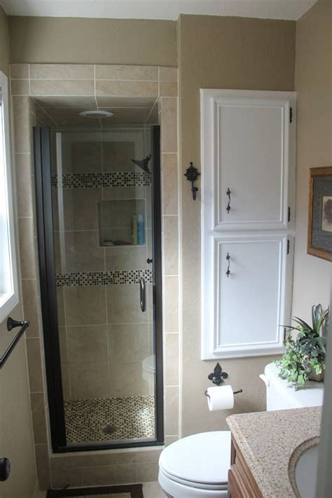 bathroom xx i am in love with this bathroom love the tile around the shower and love the cabinet