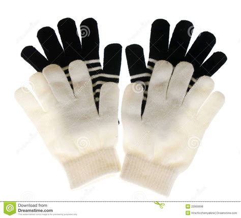 2 Pair Mittens S two pairs of gloves are white and black royalty free stock photos image 22950698